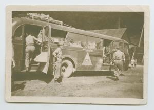 Primary view of object titled '[119th Armored Engineer Battalion Bus in Germany]'.