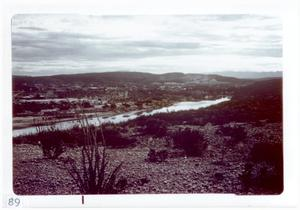 Primary view of object titled '[Body of water at Big Bend National Park surrounded by buildings and hills]'.