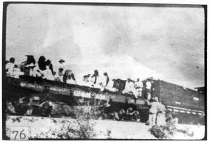 Primary view of object titled '[Mexican refugees being loaded on trains]'.