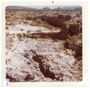 Primary view of object titled '[Inside a small, rocky canyon at Big Bend]'.