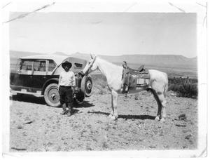 Primary view of object titled 'Feliciano Chavez with his 1928 Chevy and Horse'.