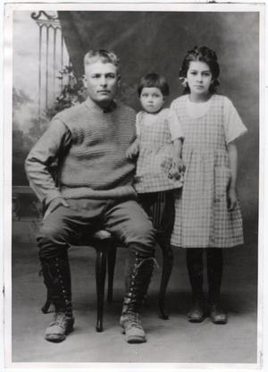Primary view of object titled '[Jesus Cabezuela and his two daughters in a family portrait]'.