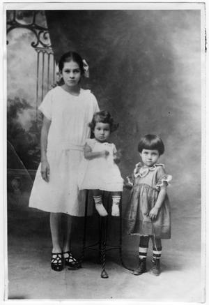 Primary view of object titled '[Three children of Jesus Cabezuela in a family portrait]'.