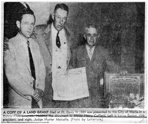 Primary view of object titled 'Newspaper article of Marfa rotarians presenting city with old land grant'.