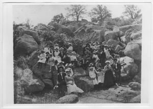 Primary view of object titled '[People Sitting on Rocks]'.