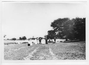 Primary view of object titled '[Photograph of Group of People Near a Pond]'.