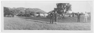 Primary view of object titled '[People Standing Near a Campground]'.