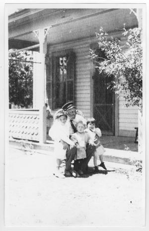 Primary view of object titled '[Photograph of a man and children]'.