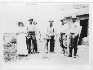 Primary view of object titled '[Group of people outside a house]'.