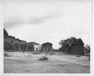 Primary view of object titled '[Photograph of Ruins of Old Hospital in Hospital Canyon'.