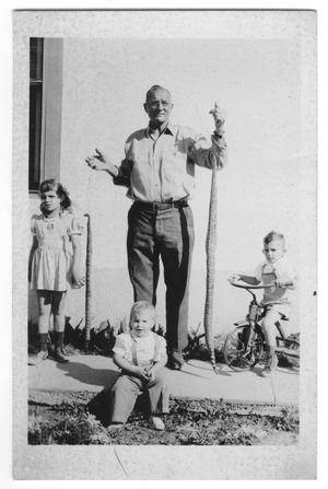 Primary view of object titled '[Photograph of Charley Bishop and grandchildren]'.