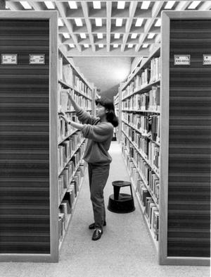 Primary view of object titled '[Student in Library]'.
