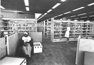 Primary view of object titled '[Library Shelves and Students]'.