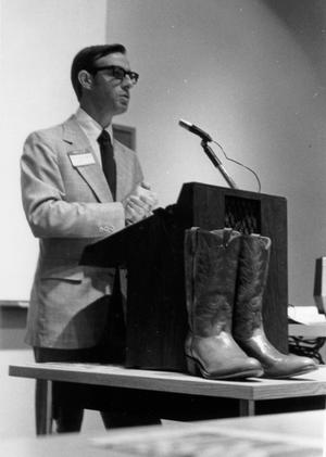 Primary view of object titled '[Don Newport speaking boots in photo]'.