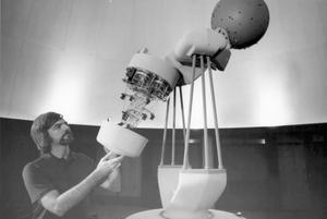 Primary view of object titled '[John D. Williams in Planetarium]'.