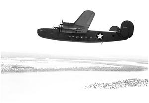 Primary view of object titled 'C-87 in flight over Possum Kingdom'.