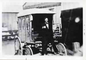 Primary view of object titled '[Man on back of ice buggy]'.