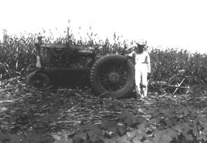 Primary view of object titled '[Gunnar Rydell with tractor in field]'.