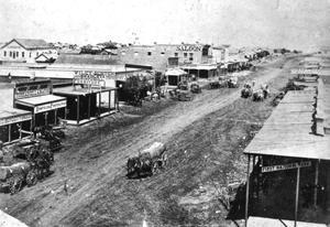Primary view of object titled '[Wagons on Main Street]'.