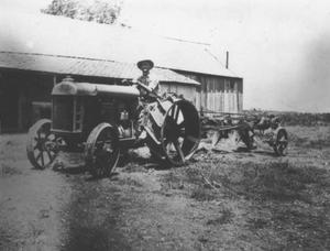 Primary view of object titled '[Man on tractor]'.