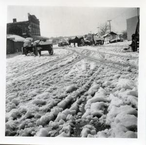 Primary view of object titled '[Street scene with snow and buggies]'.
