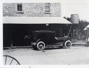 Primary view of object titled '[Building with car in front]'.