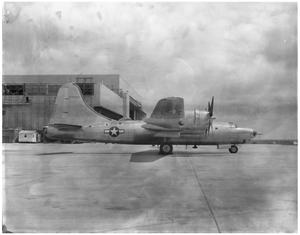 Primary view of object titled 'B-32 plane, side view, on the ground.'.