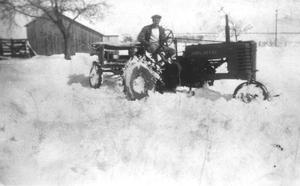 Primary view of object titled '[Man plowing snow with tractor]'.