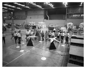 Primary view of object titled 'Employees Viewing F-111 Models'.