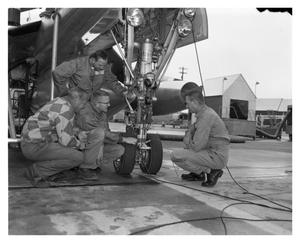 Primary view of object titled 'Crew Inspecting Plane Prior to Take-Off'.