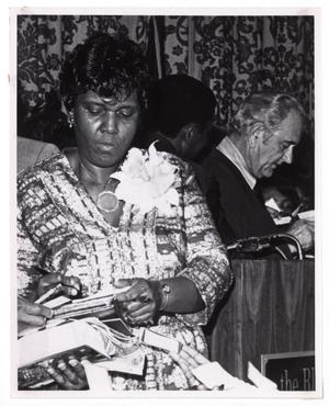 Primary view of object titled '[Barbara Jordan Signing Autographs]'.
