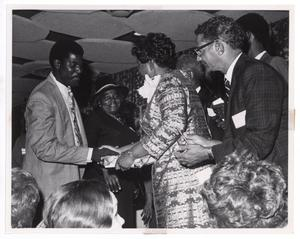 Primary view of object titled '[Barbara Jordan Shaking Hands With Guest]'.
