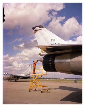 Primary view of object titled 'R.O Garlington Inspecting a B-58 Tail Gun'.