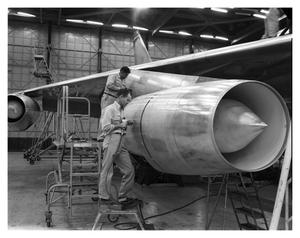 Primary view of object titled 'Crewmen Performing Assembly Work on B-58'.