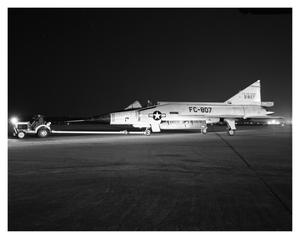 Primary view of object titled 'Convair F-102 Being Taxied At Night'.