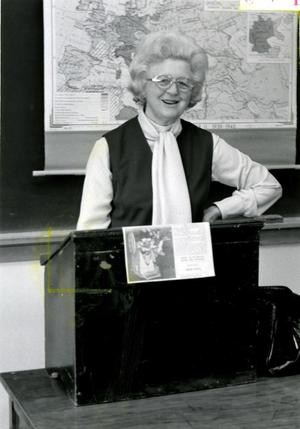 Photograph of Velma Reiff at Lectern