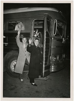 Primary view of object titled '[Photograph of Ella Bosostick and Jackie Fletcher Boarding Bus]'.