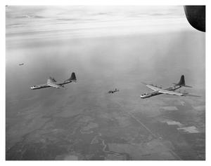 Primary view of object titled 'B-36B's and B-25 in Formation'.