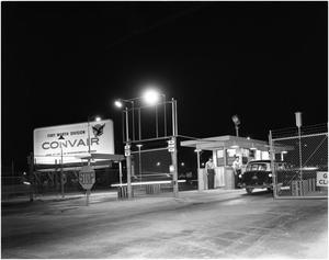 Primary view of object titled 'Car Entering Convair's Main Gate at Night'.