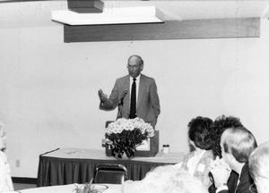 Photograph of Dr. Fletcher at a Lectern