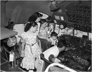 Primary view of object titled 'Palhamus Family Looks at Flight Deck'.
