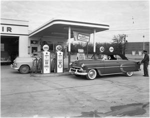 Primary view of object titled 'S.J. Middleton at Service Station'.