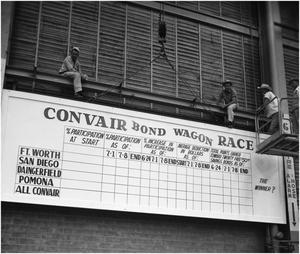 "Primary view of object titled 'Workers erect ""Bond Drive"" sign'."