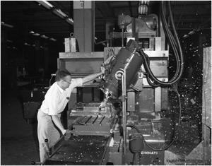 Primary view of object titled 'H.J. Knight using a milling machine'.