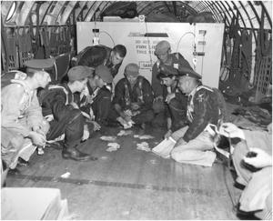 Primary view of object titled 'XC-99 crew playing cards in flight'.