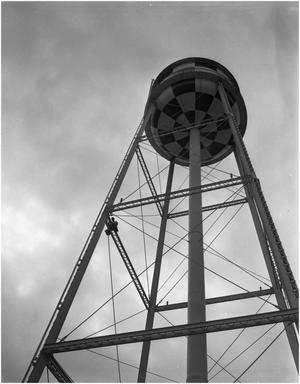 Primary view of object titled 'R.D. Reese replacing bulb on a water tower'.
