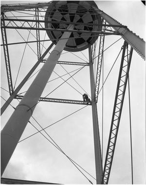 Primary view of object titled 'R.D. Reese replacing bulb on water tower'.