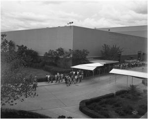 Primary view of object titled 'First Shift Employees leaving at Gate 8'.