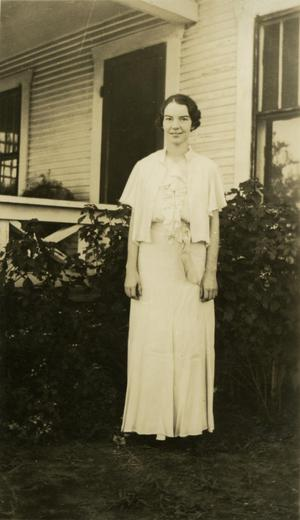 Primary view of object titled '[Photograph of Aileen Culpepper in Front of House]'.