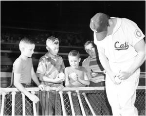 Primary view of object titled 'Cats Baseball Player Autographing a Ball'.